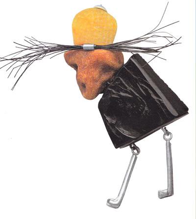 Magician, brooch, 1999, amber, silver, jet, horse hair, 6 cm