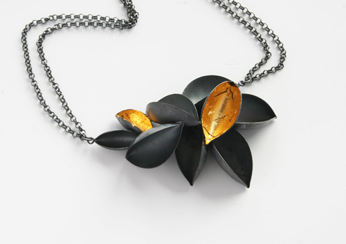Fallen Gold, pendant, 2010,  silver, patina, leaf gold, 63 mm